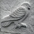 Bird carved into stone