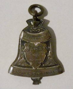Bell pendent presented to Mr Mason