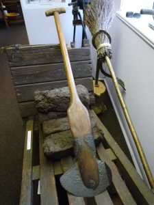 Peat spade and peat barrow originally used on the moors above Stean